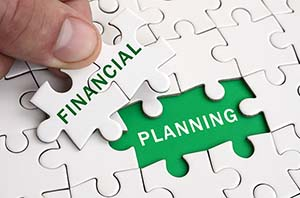 Financial planning jigsaw puzzle pieces