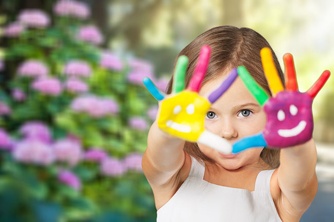 Girls with rainbow-painted hands
